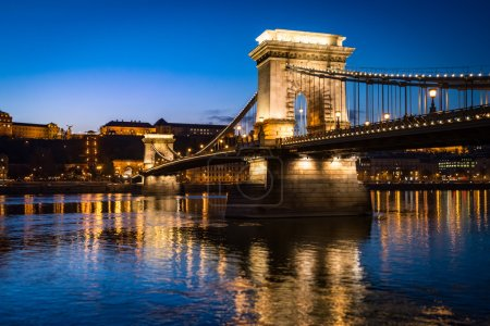 Photo for Chain bridge in Budapest, Hungary, Europe. Blue hour in city. Sky and lights reflecting in waters of Danube river. Major Landmark and tourist attraction. - Royalty Free Image