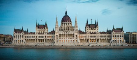 Photo for View on parliament building from Buda part of Budapest. Danube river in foreground, evening cloudy sky in background. Hungary, Europe travel. - Royalty Free Image
