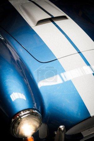 Close Up Headlight Detail of Blue Classic car....
