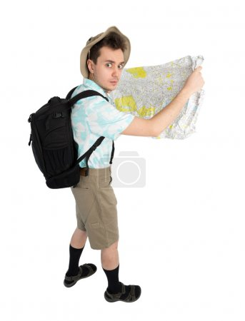 tourist with backpack and map