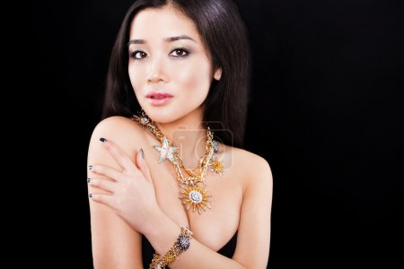 beauty portrait of a beautiful asian girl with luxury accessories. Beauty jewellery. happy fashion model