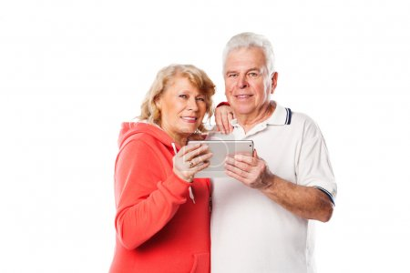 Senior couple with digital tablet surfing on the internet