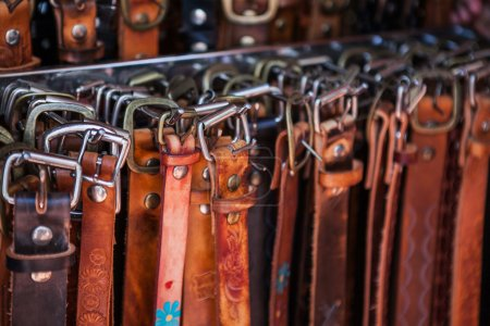 Hand crafted leather belts with unique buckles on market in Mexico