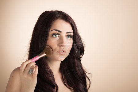 Photo for Beauty portrait of a woman using blusher make up with copy space - Royalty Free Image