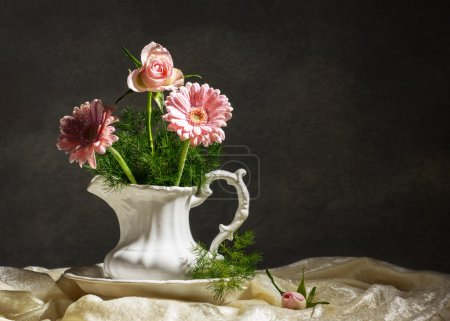 Photo for Flower arrangement in jug with artistic lighting - Royalty Free Image