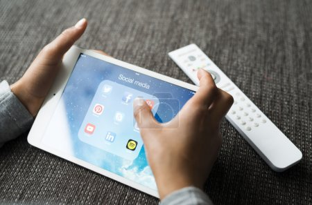 Kid playing with ipad tablet