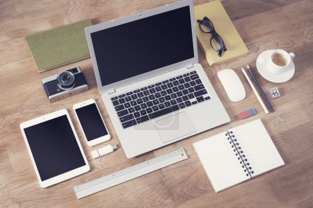 Photo for Responsive design mockup with different office items on table top - Royalty Free Image