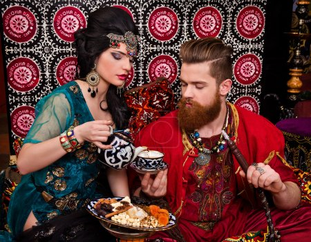 Couple in oriental costumes