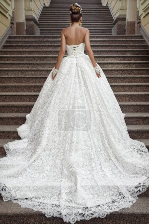 Back view of beautiful bride on stairs