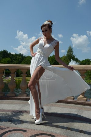 Bride in white wedding dress with a slit