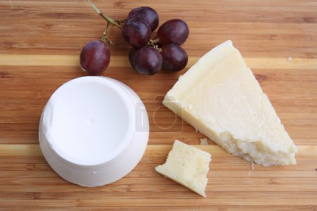 assortment of italian cheeses with grapes