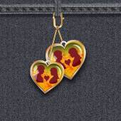 Black denim background with keyfobs in the form of glass hearts with silhouette of girl and man