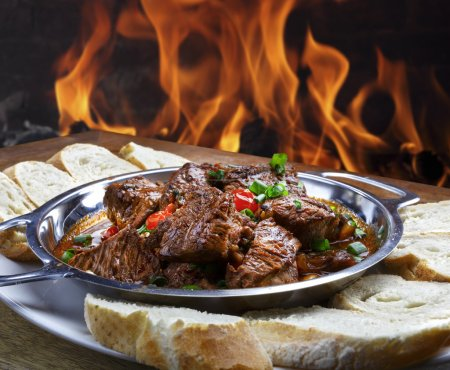 Meat with bread near fire