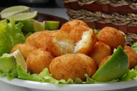 Photo for Appetizing codfish balls with lime on plate, close up - Royalty Free Image