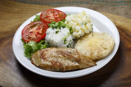 Pork steak with pineapple and rice