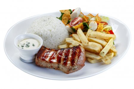 Grilled pork with fries and vegetables