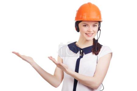 Portrait of happy cheerful young support phone operator in builder helmet