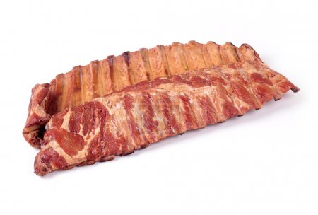 Smoked pork ribs on a white background, close-up