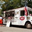 Постер, плакат: Customers Order Meals From Food Truck In Park
