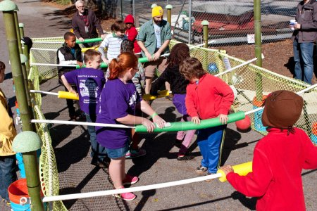 Photo pour Decatur, GA, USA - October 4, 2014:  Kids and adults play a game of human foosball at the annual Maker Faire Atlanta. - image libre de droit