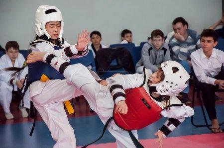 Girls fight in taekwondo