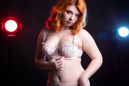 Chubby girl in underwear with two lights behind