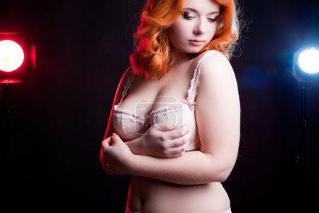 Sexy overweight woman in studio