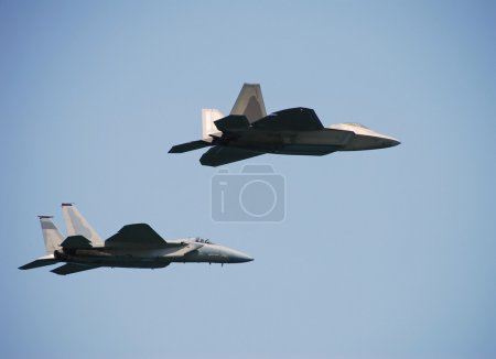 Two air force fighters in formation F-15 and F-22...