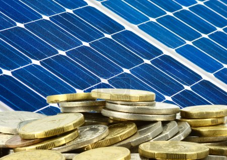 Foto de Close up of solar panel and money saving - Imagen libre de derechos