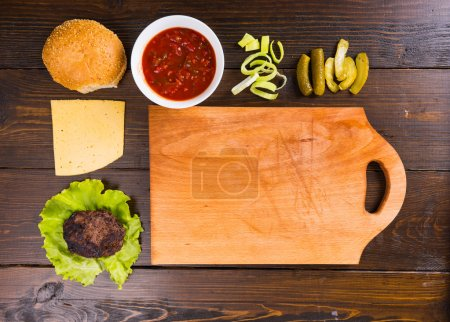 Hamburger Ingredients with Wooden Cutting Board