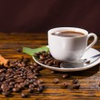 Постер, плакат: Cup of Coffee with Roasted Beans and Spices
