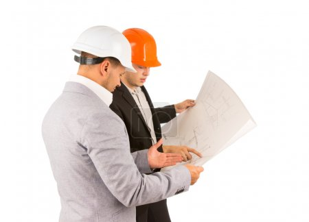 Two young engineers discussing a building plan