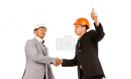 Two Young Angry Male Engineers Shaking Hands
