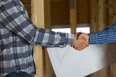 Architect and Client Showing Handshake Gesture