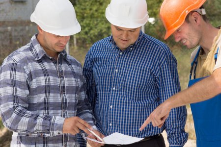 Builder, engineer and architect having a meeting