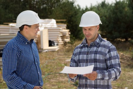 Building Planners Talking at the Construction Site