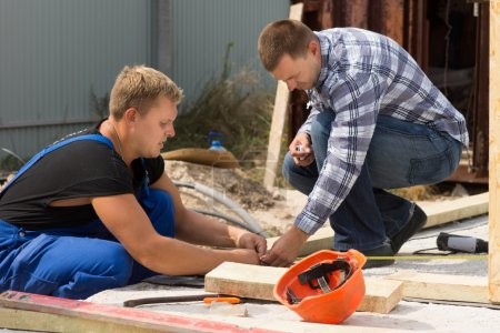 Two workmen working on a building site