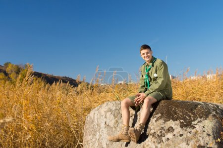 Boy Scout on Large Rock at the Camp Area