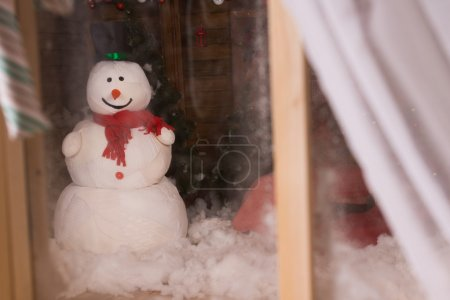 Christmas snowman outside in the darkness