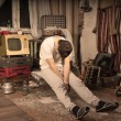 Постер, плакат: Young Man Taking a Nap at Messy Abandoned Room