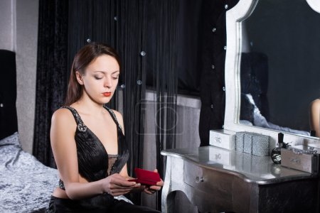 Gorgeous Woman at her Room Holding Make up Kit