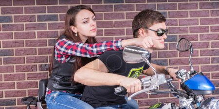 Close up Young White Couple Riding a Motorcycle