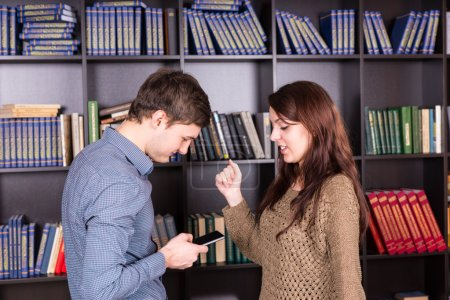 Young Lovers Looking at Mobile Phone Together