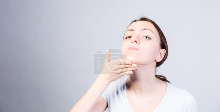 Woman Tilting her Head While Lifting her Chin