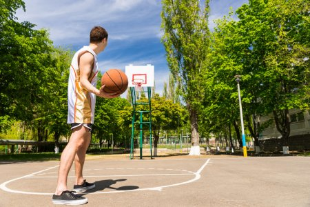 Athletic Man Free Throwing Basketball Toward Hoop
