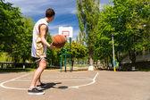 Athletic Man Free Throwing Basketball Toward Hoop