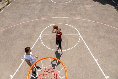 High Angle View of Couple Playing Basketball