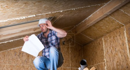 Builder Reading Plans Inside Unfinished Home