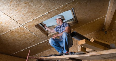 Builder Inspecting Skylight in Unfinished House