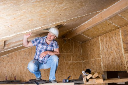 Builder on Scaffolding in Unfinished House